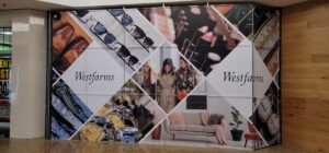 Mall collateral and retail barricade wraps by Seamless Wraps